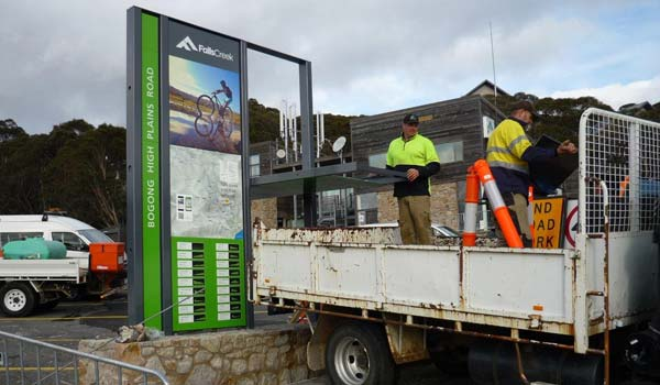 Dual season signage at Falls Creek being changed from summer to winter modes
